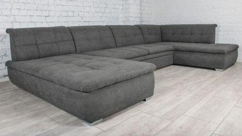 liels ērts mīksts u formas dīvāns izvelkams