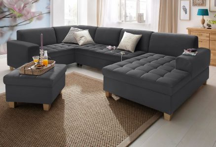 Melns ādas u formas dīvāns ar pufu