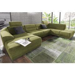 Liels zaļš dīvāns no auduma ar diviem stūriem
